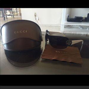 White Gucci shield sunglasses.  Missing cloth